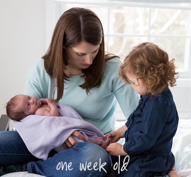 one week old with big sister